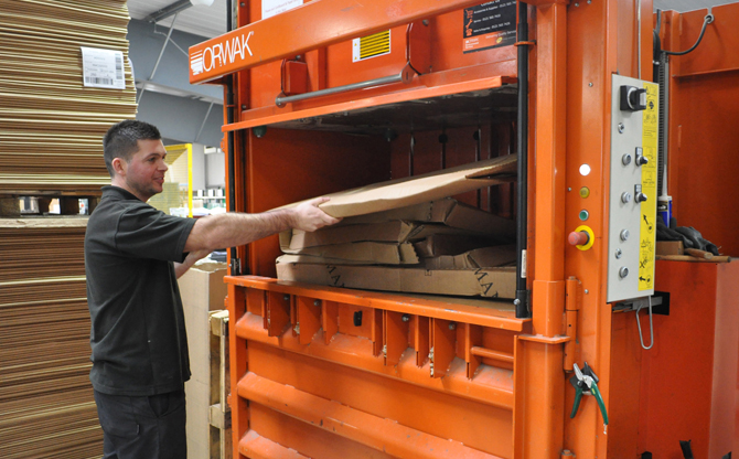 Ian Simpson, Health & Safety, Environmental & Facilities Officer, operating our Cardboard Compactor