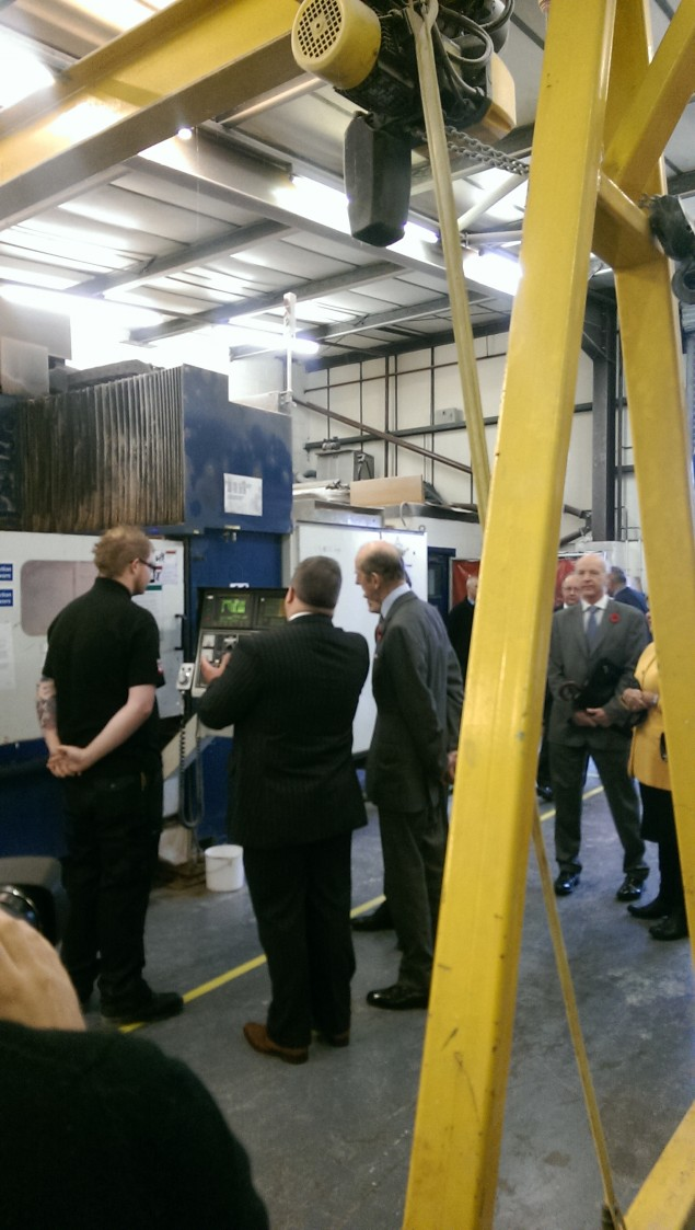 Jamie our Tray Plant Apprentice showing The Duke of Kent our CNC Machine