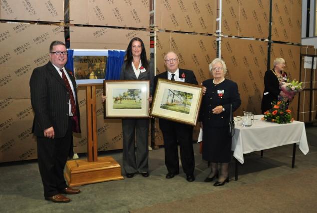 Gerry and Deborah presented with their paintings